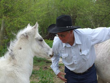 Bryant Rickman with white foal